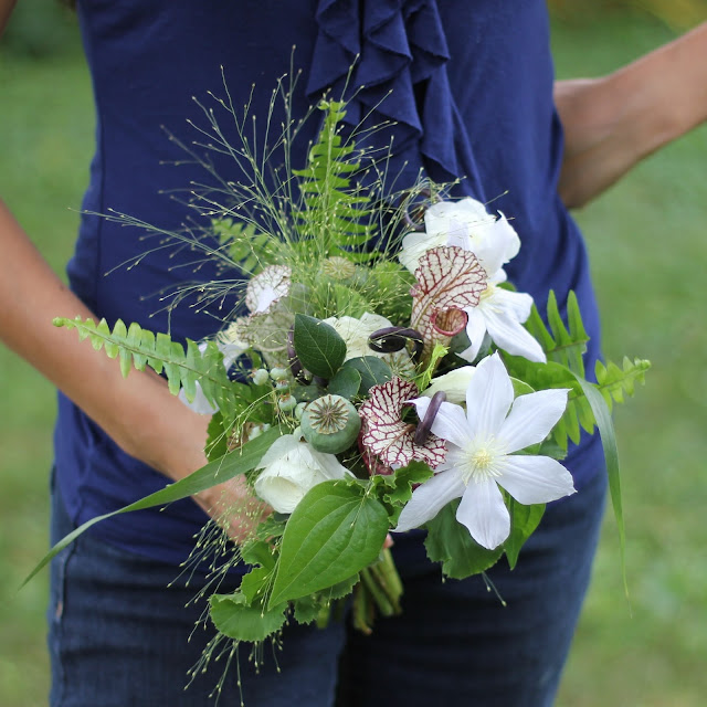 Bridesmaids bouquets were woodsy wild collections of fern curls, clematis, poppy bods, sword fern, explosion grass, wild blueberries, ranunculus, dracaena, and geranium foliage.sweet pea floral design ann arbor detroit wedding flowers misty farms fruit farms rustic woodsy barn wedding