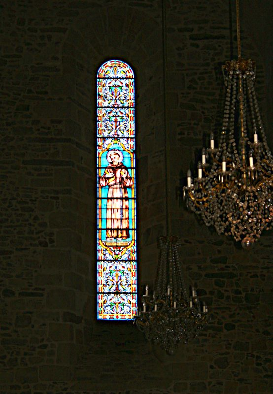 tall and narrow stained glass window