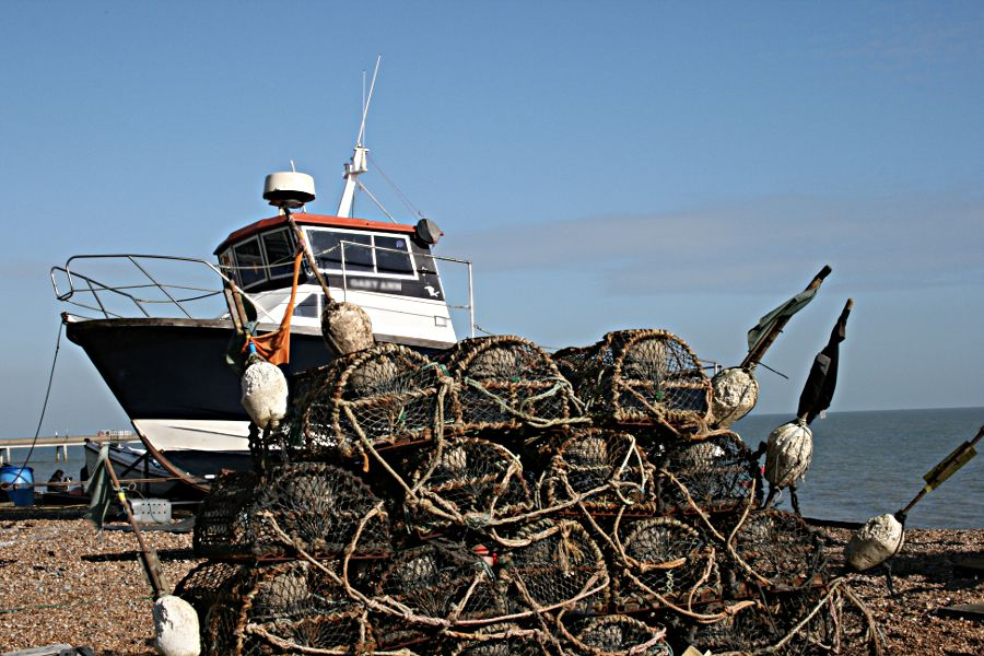 fishing boat and lobster pots on beach