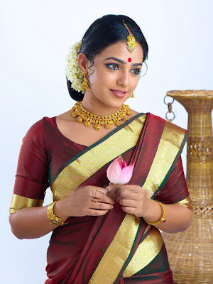Actress Nithya Menon in Saree Pictures Gallery
