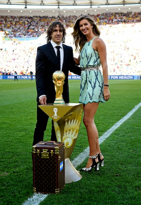 2014 FIFA World Cup Trophy protected by specially commissioned Louis Vuitton trunk and escorted by Carles Puyol and Gisele Bündchen.jpg