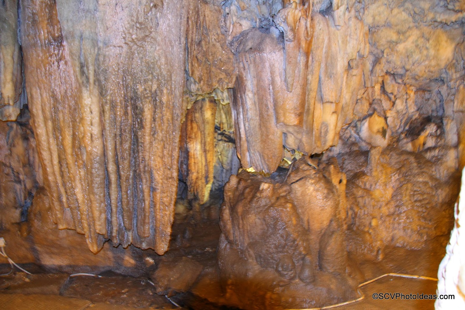 Drogarati Cave massive stalactite formations with flash