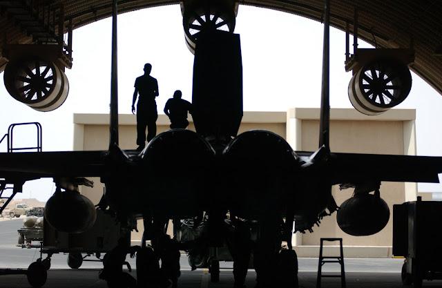 Maintainers work on a F-15E Strike Eagle.
