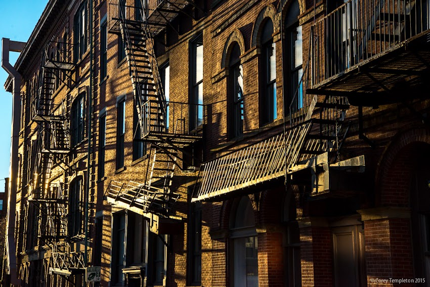 Portland, Maine USA November 2015 Photo by Corey Templeton. The morning light along upper Market Street. The reflection of the light against the fire escapes catches your eye from a distance.