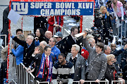 to photograph the Super Bowl Champion Giants parade down.
