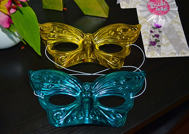 mint and gold mardi gras masks