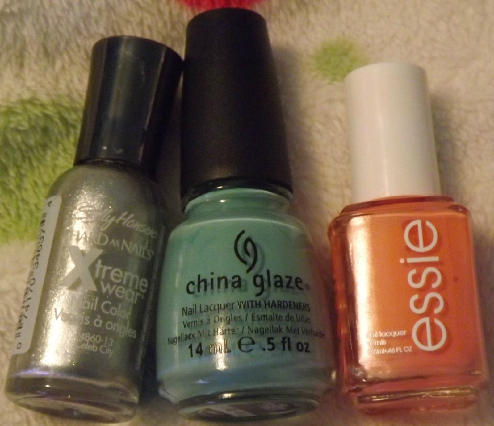 "Left to right: Sally Hansen Xtreme Wear in ""Celeb City,"" China Glaze"