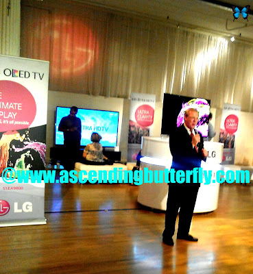 LG Electronics John Taylor shows off the 55-inch 55EA9800 ($9,999) curved-screen Full HD 1080p OLED TV at the Rand Luxury Review in New York