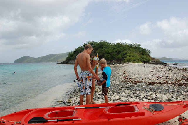 Three of our children with kayaks and snorkels at Waterlemon Cay