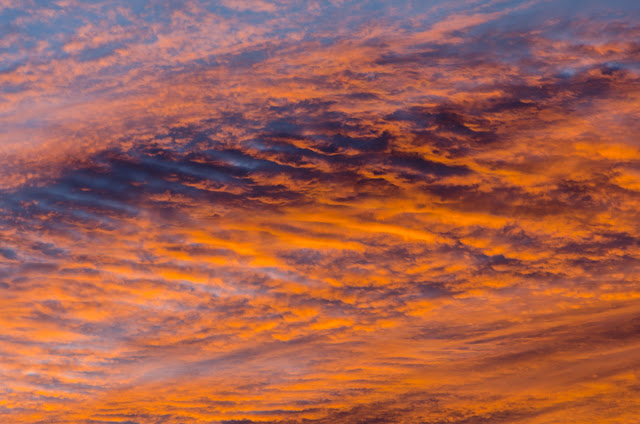 red sunrise on clouds