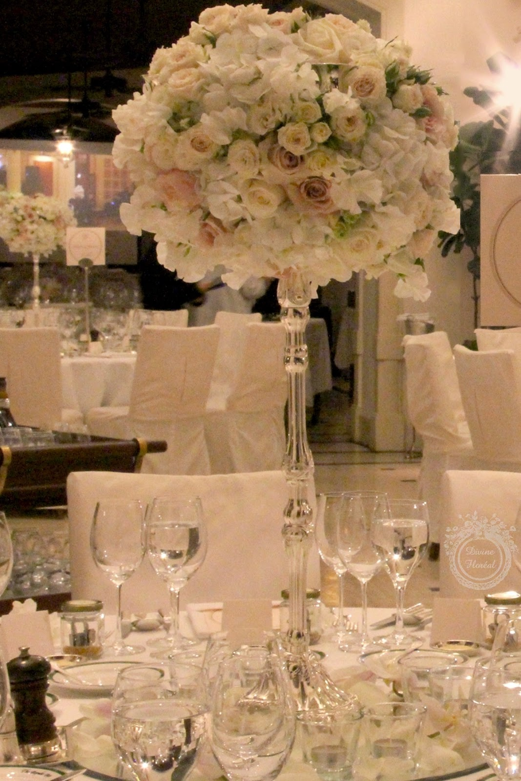 Divine floral dreamy parisian wedding at repulse bay glamorous tall silver candelabra centerpieces for the head tables in the center arubaitofo Choice Image
