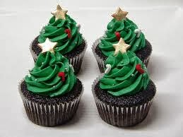 four cupcakes made in Australia with a Christmas Theme