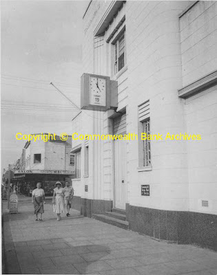 Clock on bank in 1956