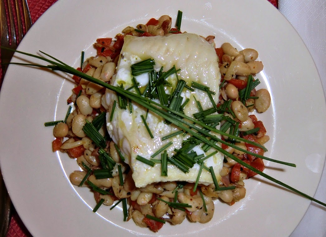 Sea bass on bed of white beans, red bell pepper and pancetta