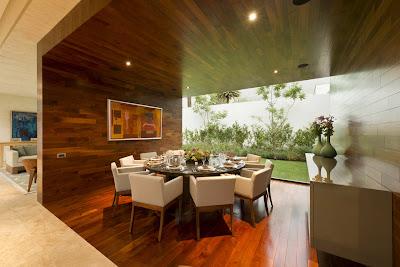 ديكورات بركيه جميله Cozy-dining-room-with-wooden-walls-and-floor.jpg