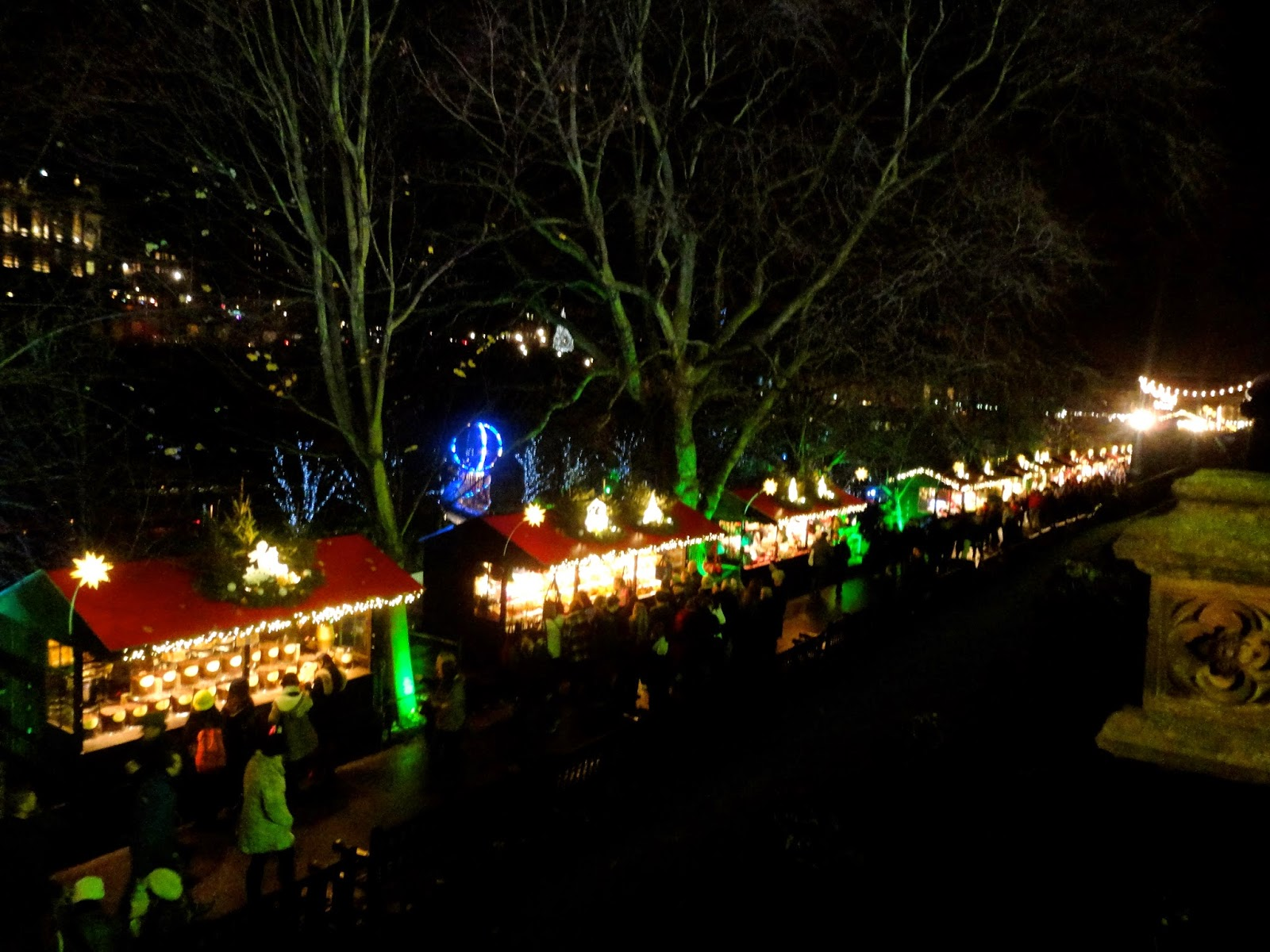 German market stalls in Edinburgh Winter Wonderland at Christmas in Princes Street Gardens