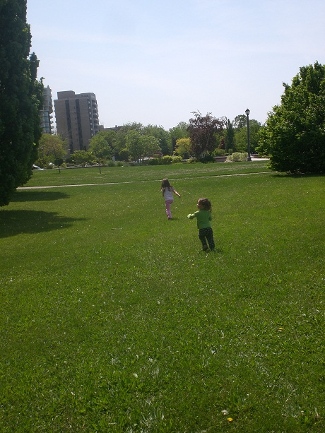 Sisters playing at the riverfront park.