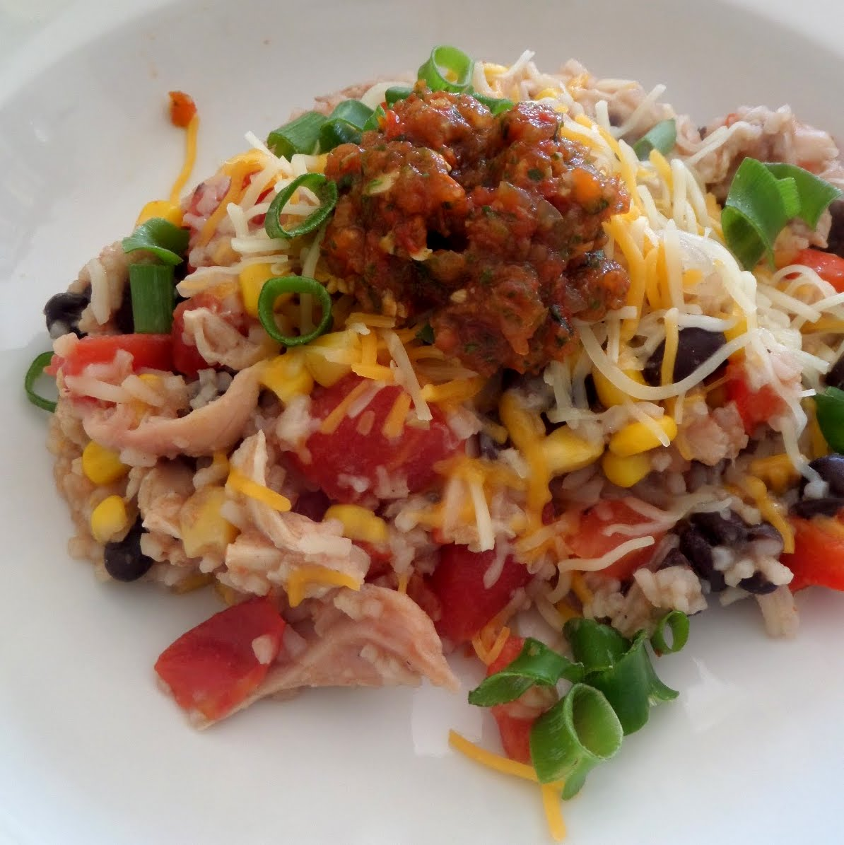 Chicken Burrito Bowls:  Chicken, peppers, corn, beans, and rice all mixed together with tomatoes.  Ready to eat or wrap in a tortilla.