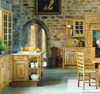 A yellow kitchen in an old castle.