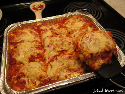 Serving Lasagna From the Oven