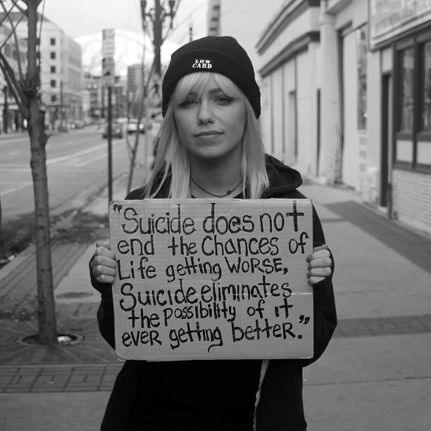 Jenna McDougall with the suicide sign
