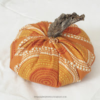 DIY spiced fabric pumpkins fall centerpieces - add the stump