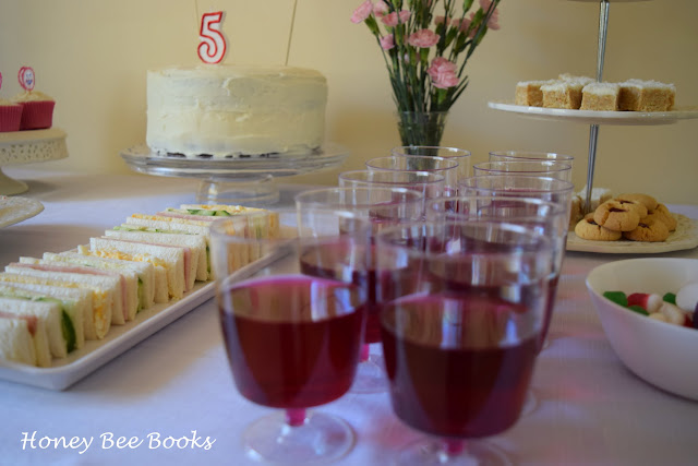 Refreshments table including finger sandwiches and jelly cups