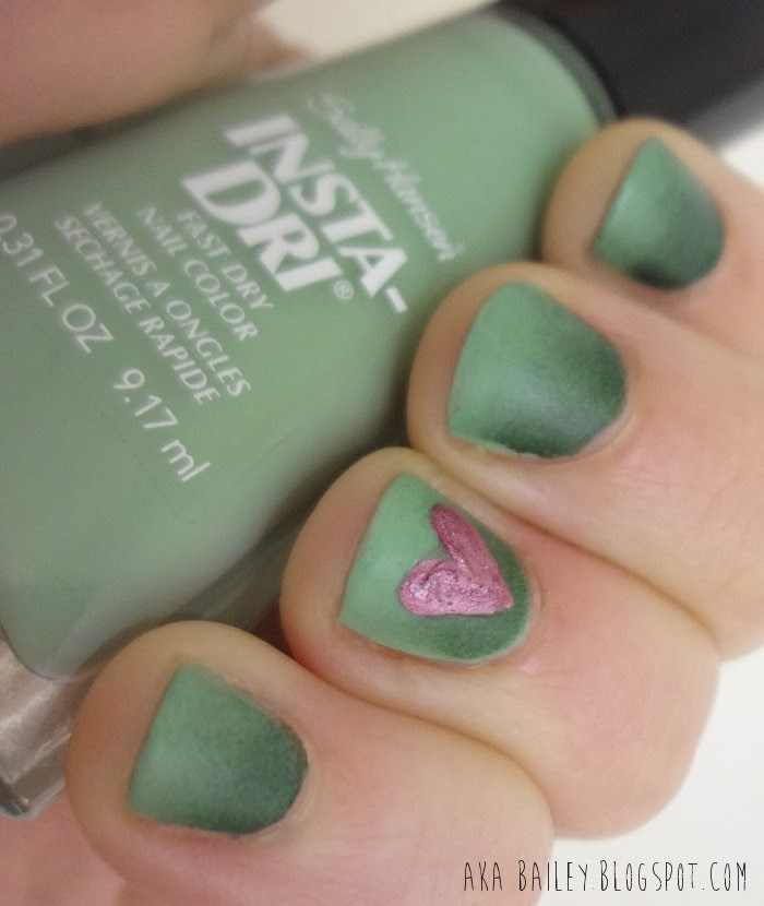 Green mint ombre nails with an orchid heart accent