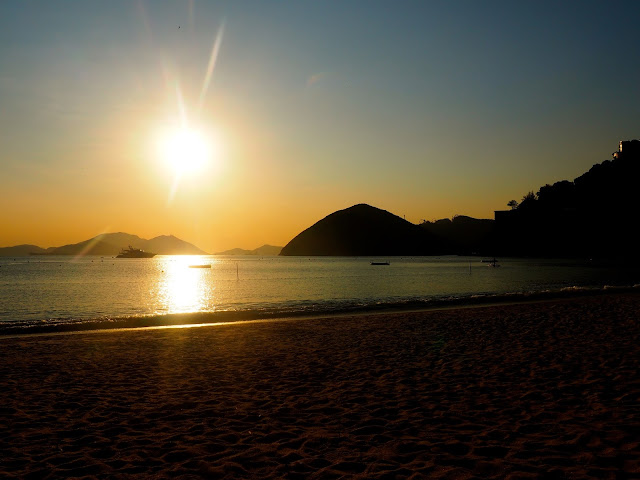Sunset by the ocean and sand on Repulse Bay Beach, Hong Kong