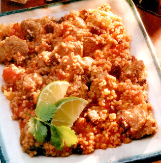 Lamb couscous: Classic moroccan stew of spiced lamb served on a bed of couscous.