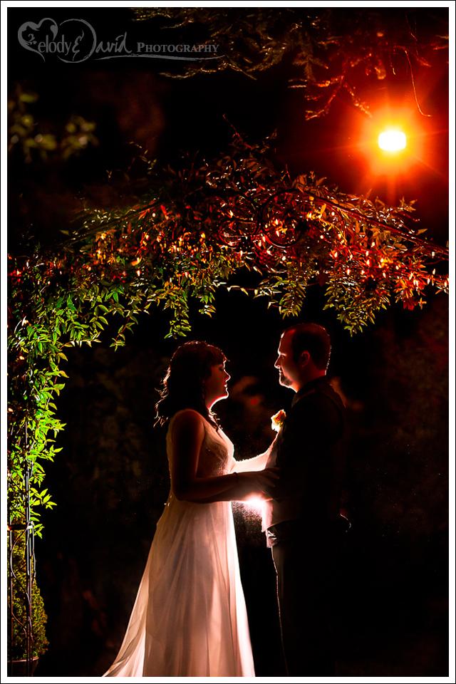 Bride and groom under Harmony Wynelands arbor