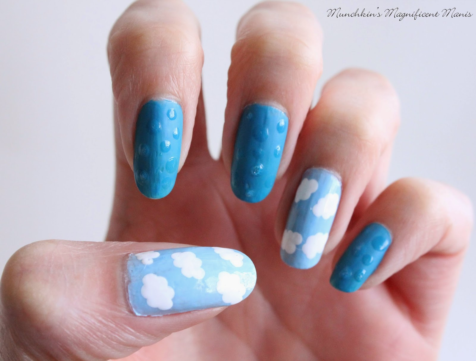 Rain drops and clouds nail design