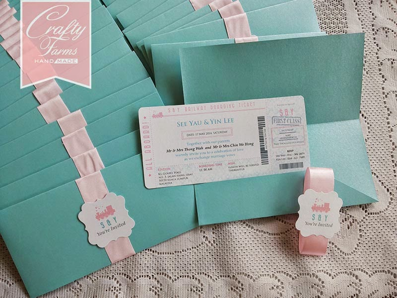 train ticket themed wedding card in baby pink and turquoise mint