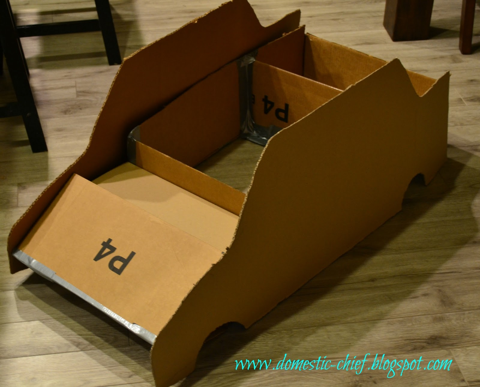 chief domestic officer cardboard box police car