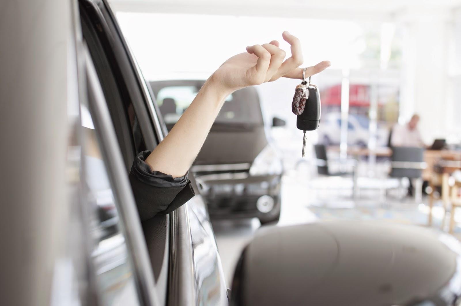 Woman dangling keys out of car window