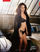 Berenice Marlohe wearing lingerie and standing between the cars