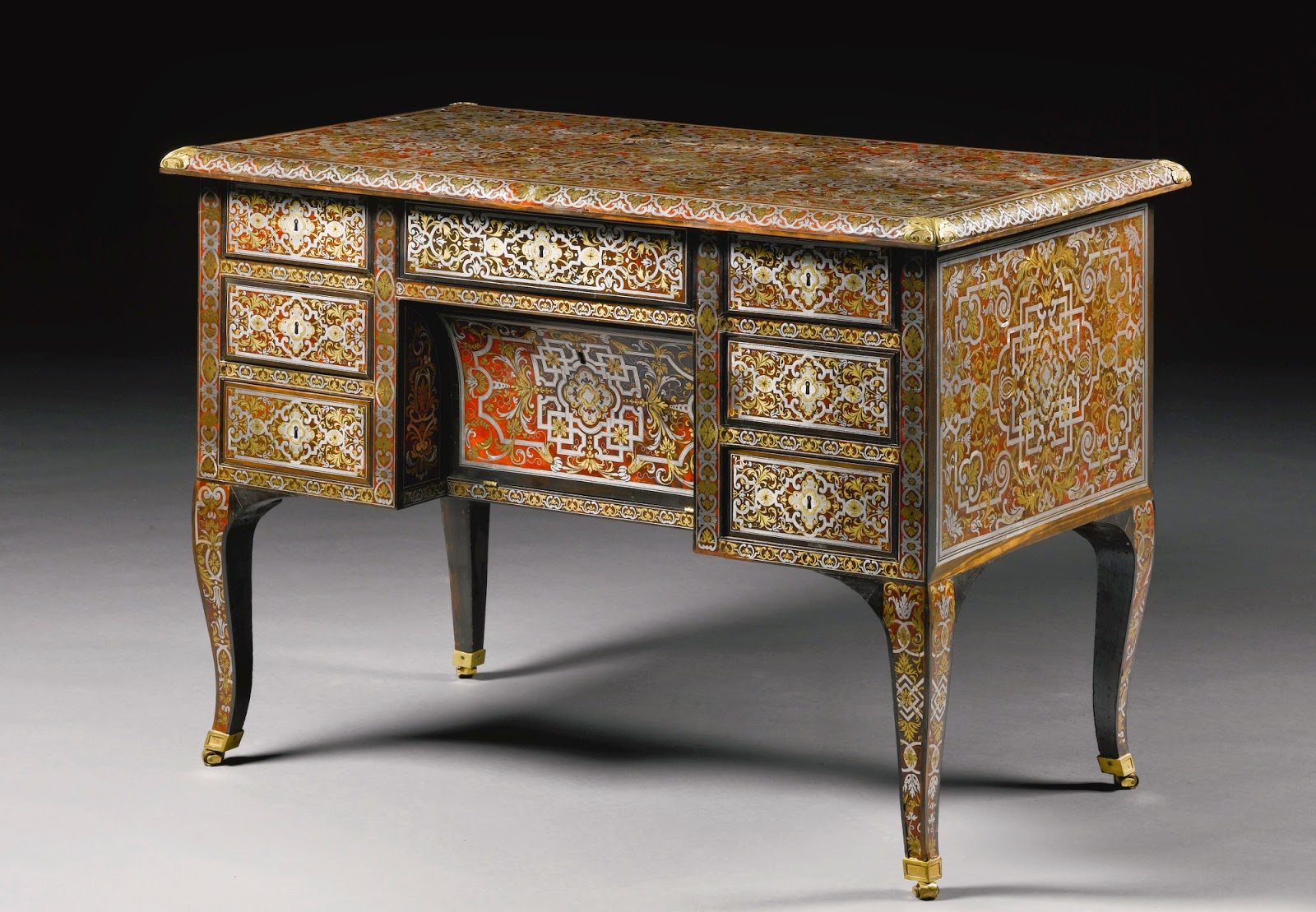 AN ENGRAVED BRASS AND PEWTER INLAID TORTOISESHELL PREMIÈRE-PARTIE BOULLE MARQUETRY AND EBONY BUREAU MAZARIN ATTRIBUTED TO ALEXANDRE-JEAN OPPENORDT (1639-1715) AND STAMPED I DUBOIS (1693-1763), LOUIS XIV, CIRCA 1685, RESTORED BY JACQUES DUBOIS, CIRCA 1750, Sotheby's