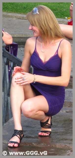 Smiling girl in blue summer  mini dress