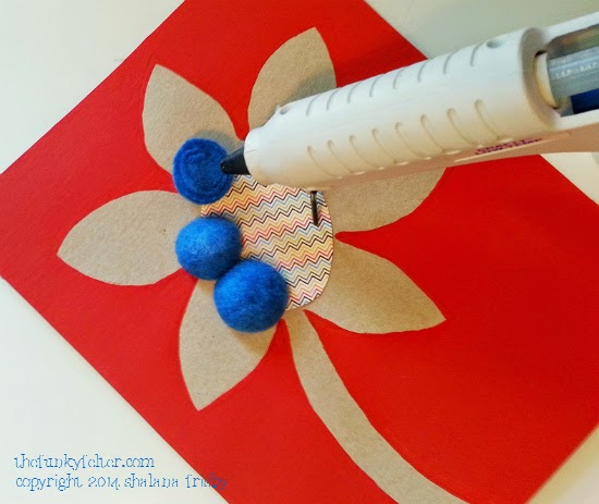 glue on felted wool balls to recycled flower cardboard wall art step 4