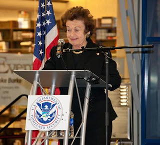 Ms. Weissmann Klein speaks about her work at the Outstanding American by Choice ceremony at the Mall of America