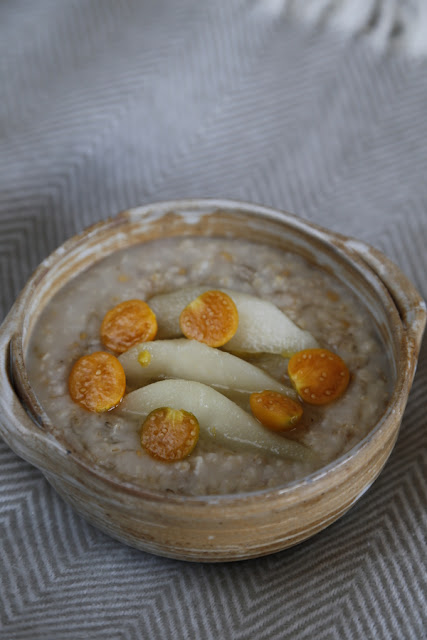 A bowl of porridge with pears
