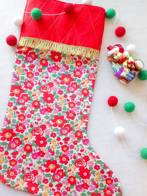 Liberty Christmas Stocking handmade with gold trim besty print