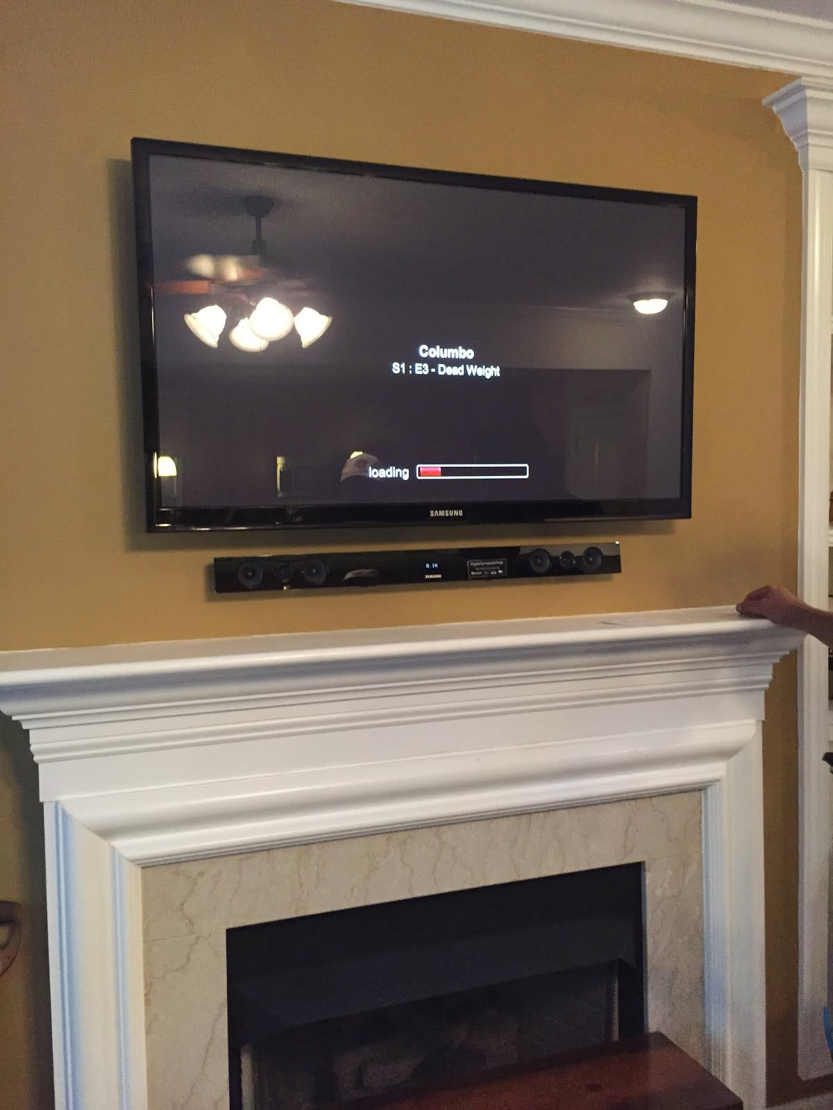 Tv wall mounting charlotte nc hdtv mounting on stone for Tv over fireplace