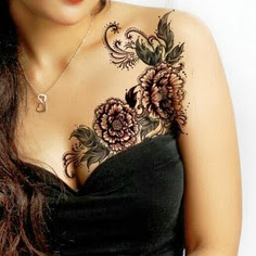 Tattoo for girls:lotus, flower on chest
