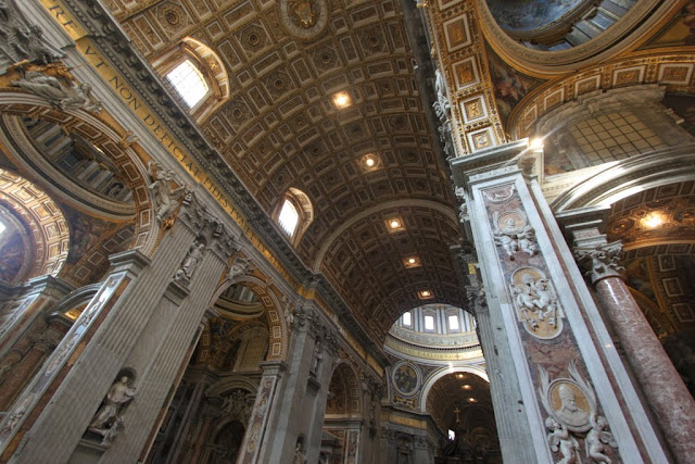 The details mosaics and marbles decoration including statues in St Peter's Basilica in Vatican City, Rome, Italy