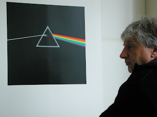 Storm Thorgerson in front of Pink Floyd album art