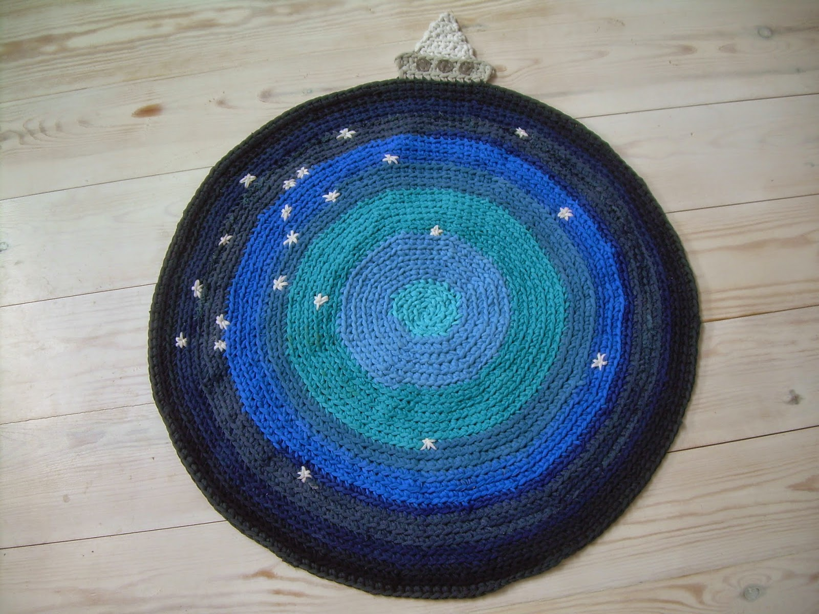 https://www.etsy.com/listing/202742841/the-boat-in-a-sea-of-stars-circular-rug?ref=shop_home_active_1