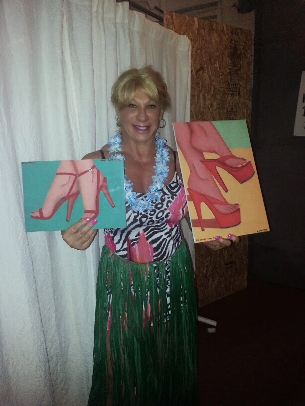 Kat Connors holding two of the prints (Pretty Feet and Put Yourself in her Shoes) at the Jacksonville Footnight™ Party on Jan 3rd 2015