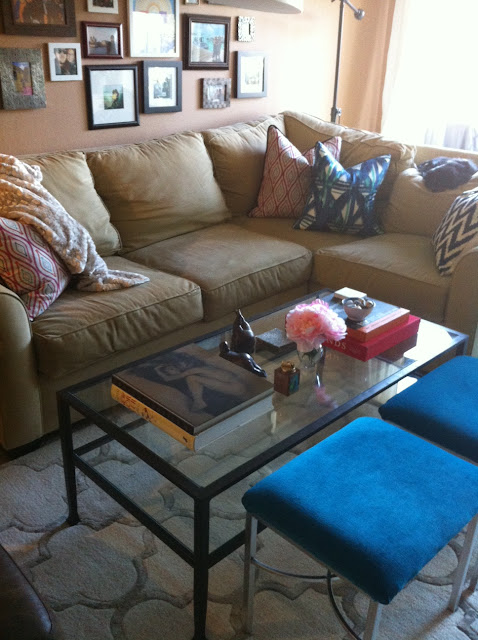 Living room before and after, Coffee table before and after, before and after, coffee table style, coffee table styling, coffee table design, coffee table vignette, patterned pillows, bench seats, velvet bench seats, turquoise bench seats, small l-shape couch, trellis rug, lattice rug, Side table vignette, pink flowers, pink peonies, fat yoga, coffee table books, horn lamp, sheep skin throw, brown club chair, glass knot, iron and glass coffee table, living room design, succulent, made her look, madeherlook.net, madeherlook.blogspot.com