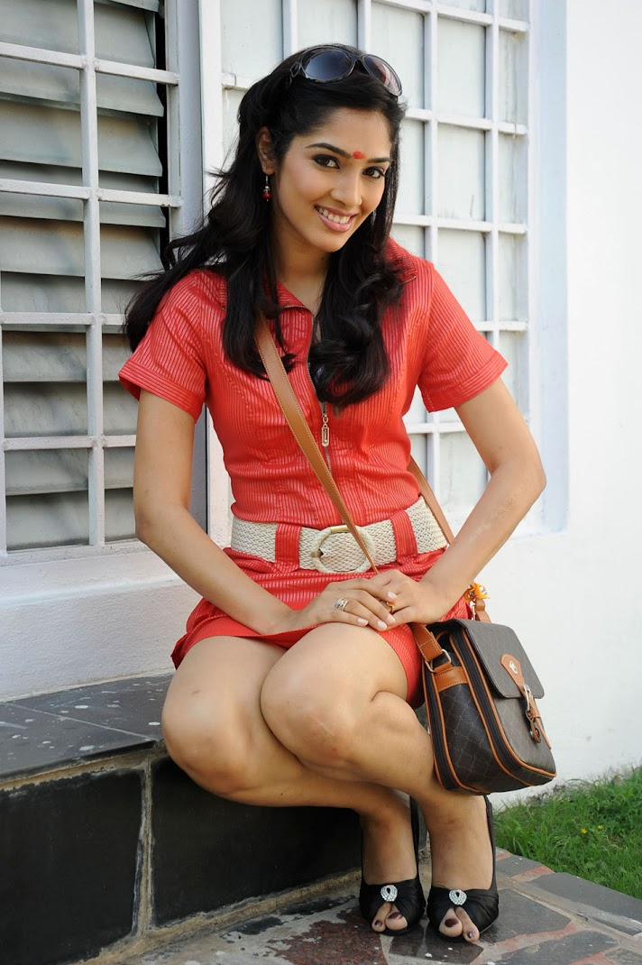 Rishika Pics in Orange Top